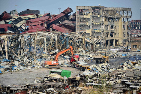 TIANJIN - AUGUST 17: Rescuers work at the blast site during the aftermath of the warehouse explosion on August 17, 2015 in Tianjin, China. The death toll has risen to 114 following last Wednesday night's explosion at a warehouse in the Binhai New Area of Tianjin. (Photo by ChinaFotoPress/Getty Images)
