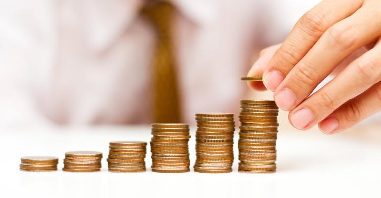 businessman stacking coins money