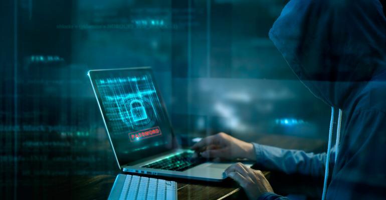 hoodie hacker in a dark room
