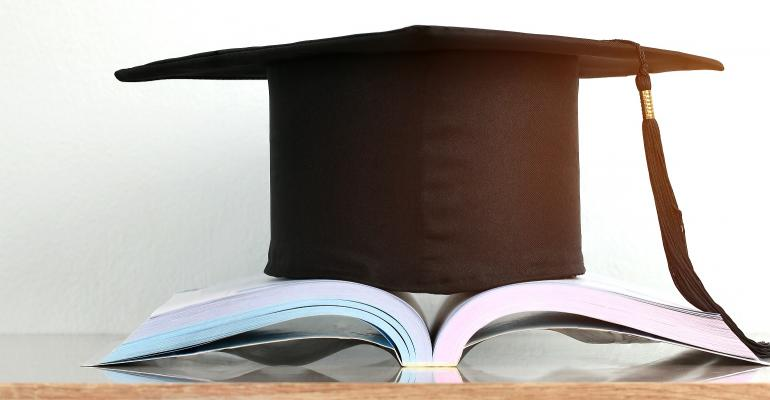 Mortarboard atop open book