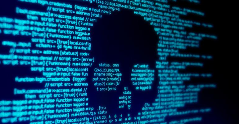 Computer code on a screen with a skull representing a computer virus / malware attack
