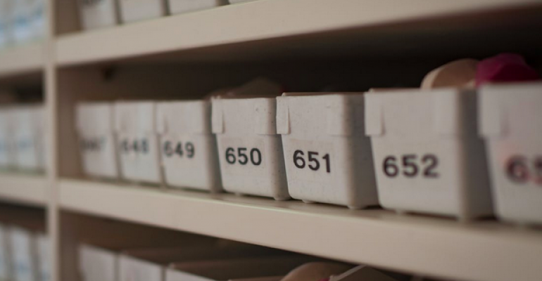 Containers with numbers on shelves.png