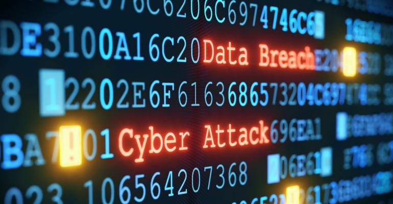 A close-up on an abstract design of a computer display, which is warning about a cyber attack.