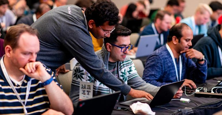 Developers participate in a hackathon at Google Cloud Next 2019