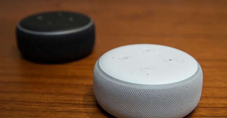 Amazon Echo devices sit on table