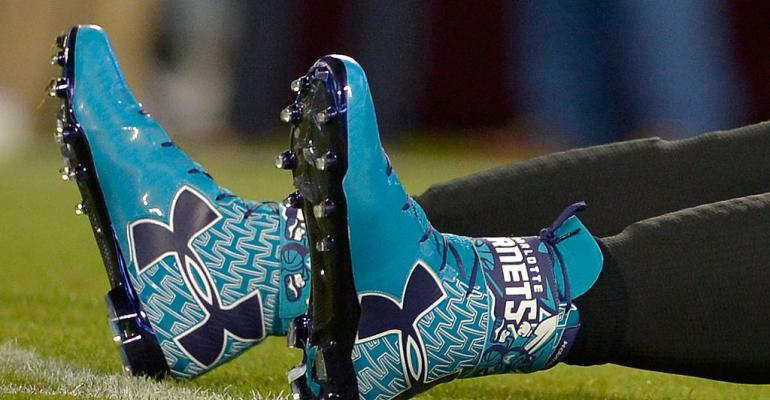 CHARLOTTE, NC - OCTOBER 30:  Detail photo of UnderArmour Charlotte Hornet cleats worn by Cam Newton #1 of the Carolina Panthers before a game against the New Orleans Saints at Bank of America Stadium on October 30, 2014 in Charlotte, North Carolina.  (Photo by Grant Halverson/Getty Images)