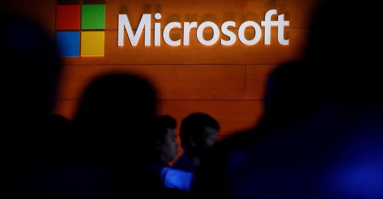 microsoft logo in shadowy crowd