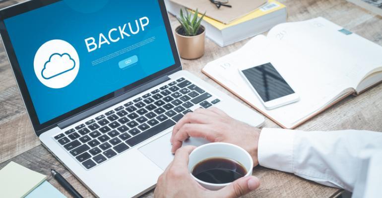 Man backing up laptop