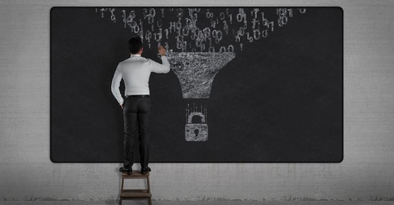 man-writing-on-chalkboard