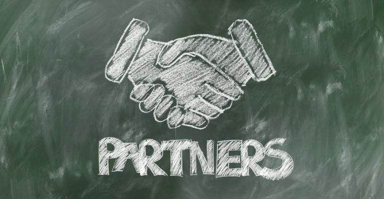 Illustration of handshake over word partner.png