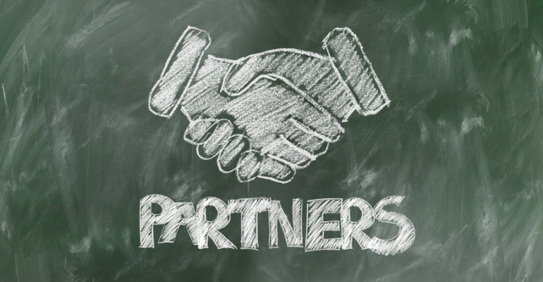 Illustration of handshake over word partner.png