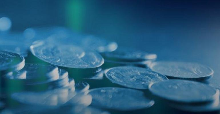 Close-up image of a pile of coins against a blue background
