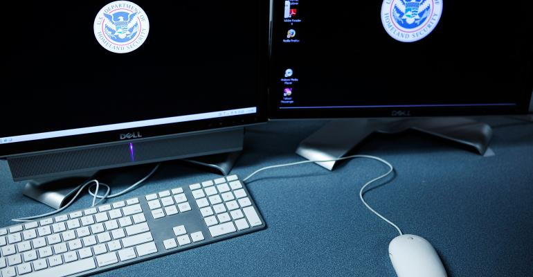 Logos of the US Department of Homeland Security on computer terminals in a training room of the Cyber Crimes Center of the US Immigration and Customs Enforcement in Fairfax, Virginia, in 2009