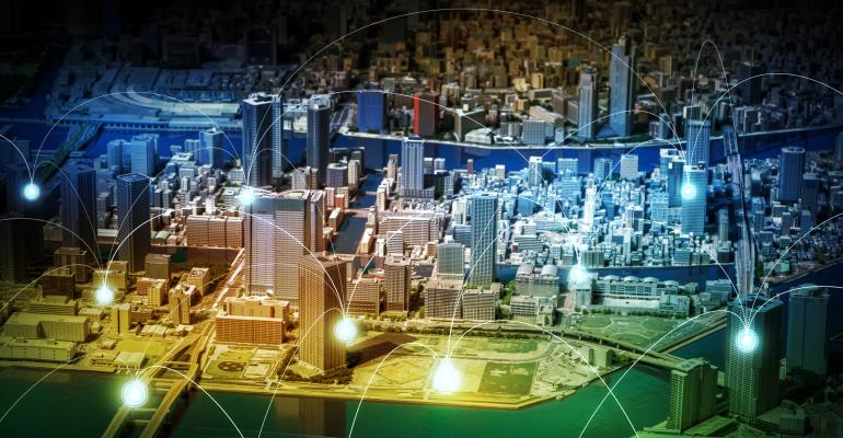 Image shows a smart city diorama and wireless sensor network.