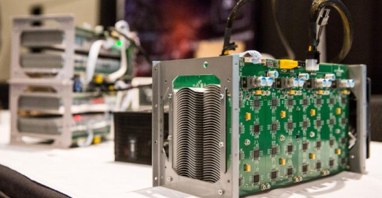 Bitcoin mining hardware on display at a conference in New York in 2014