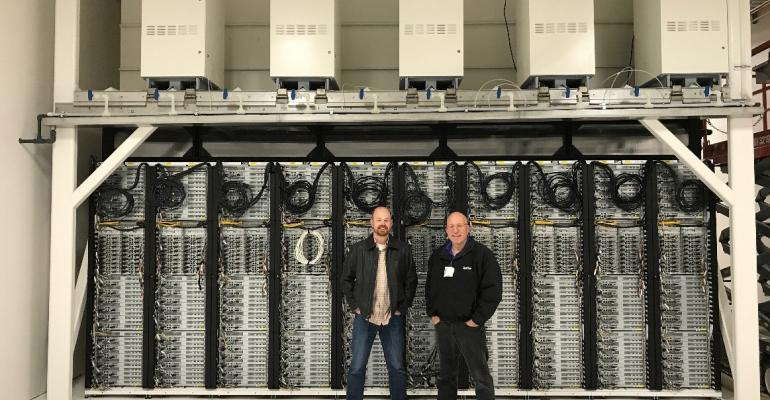 Microsoft researchers Christian Belady and Sean James in the company's Advanced Energy Lab, a pilot natural gas-powered data center