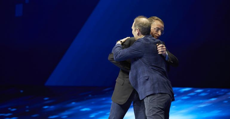 VMware CEO Pat Gelsinger and AWS CEO Andy Jassy hug on stage at VMworld 2018 in Las Vegas