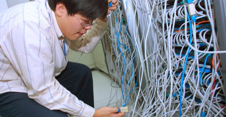 "South Korean engineer checks systems after a worm called ""SQL Slammer"" attacked internet servers in the country in 2003"