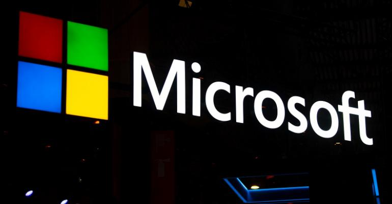 A logo sits illuminated outside the Microsoft booth on day 2 of the GSMA Mobile World Congress 2019 on February 26, 2019 in Barcelona, Spain.