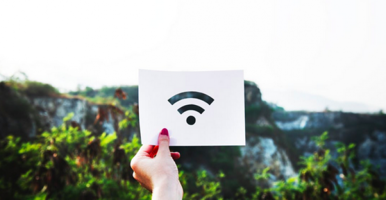 Person holding Wi-Fi symbol on card.png