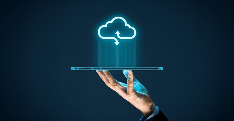 Person holding laptop cloud computing.jpg