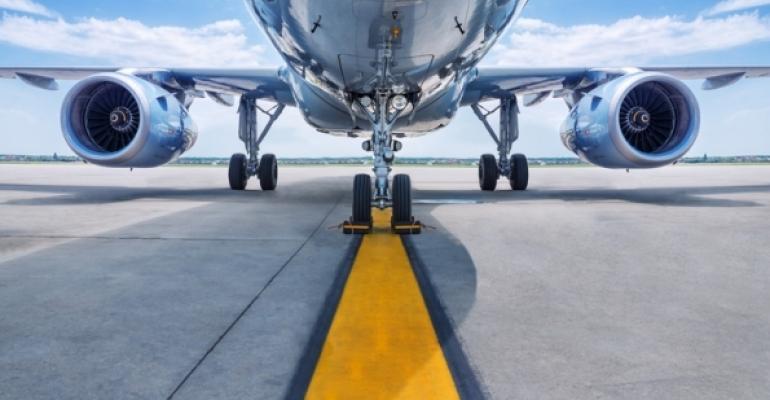 Underside of airplane on runway