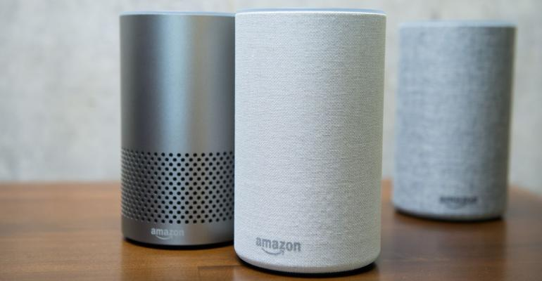 The new Amazon.com Inc. Echo devices sit on display during the company's product reveal launch event in downtown Seattle, Washington, U.S., on Wednesday, Sept. 27, 2017. Amazon unveiled a smaller, cheaper version of its popular Alexa-powered Echo speaker that the e-commerce giant said has better sound. Photographer: Daniel Berman/Bloomberg