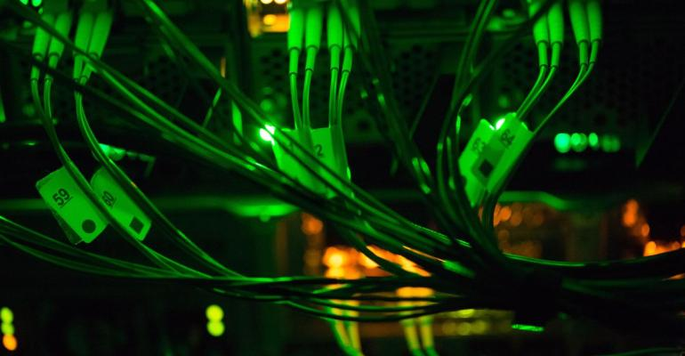 Green light illuminates optical cables connected to data rack servers in the server room of the Sberbank PJSC data processing center (DPC) at the Skolkovo Innovation Center, in Moscow, Russia, on Tuesday, Dec. 26, 2017. Sberbank PJSC, Russia's most valuable company, will boost its dividend payout to 50 percent of profit or higher, just not as quickly as some investors had hoped.