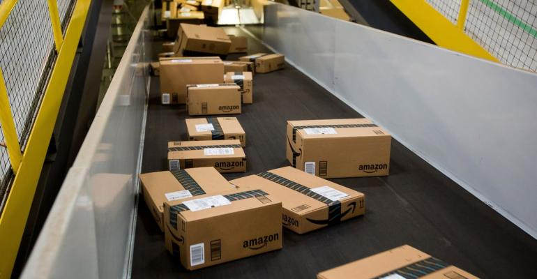 Boxes move along a conveyor belt at the Amazon.com Inc. fulfillment center on Cyber Monday in Robbinsville, New Jersey, U.S. Photographer: Michael Nagle