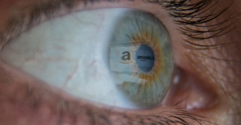 Closeup of eyeball with reflection of Amazon logo