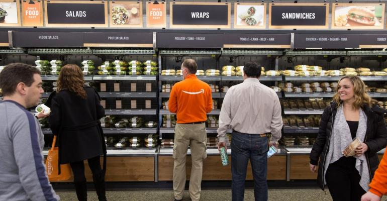 Amazon.com Inc. employees shop at the Amazon Go store in Seattle. Photographer: Mike Kane/Bloomberg