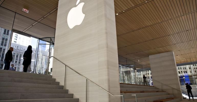 Signage is seen during a media preview of the new Apple Inc. Michigan Avenue store in Chicago, Illinois, U.S., on Thursday, Oct. 19, 2017. The building features exterior walls made entirely of glass with four interior columns supporting a 111-by-98 foot carbon-fiber roof, designed to minimize the boundary between the city and the Chicago River. Photographer: Daniel Acker/Bloomberg