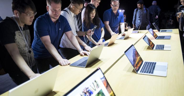 Attendees look at the new Apple Inc. MacBook Pro laptop computers during the Apple Worldwide Developers Conference (WWDC) in San Jose, California, U.S., on Monday, June 5, 2017. Photographer: David Paul Morris/Bloomberg