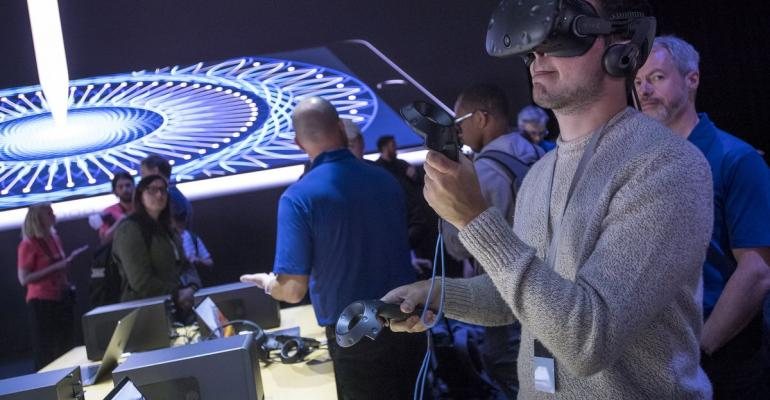 An attendee at Apple's Worldwide Developers Conference tests a virtual reality headset.