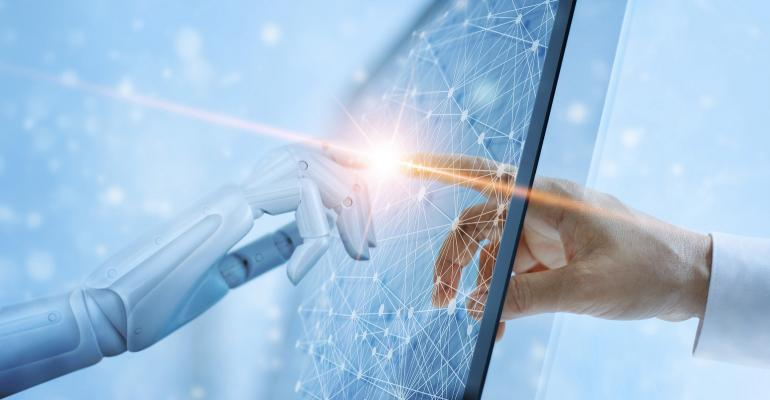 human hand and robot hand touching computer screen