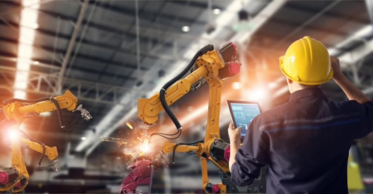 Image shows welding robotics and digital manufacturing operation.