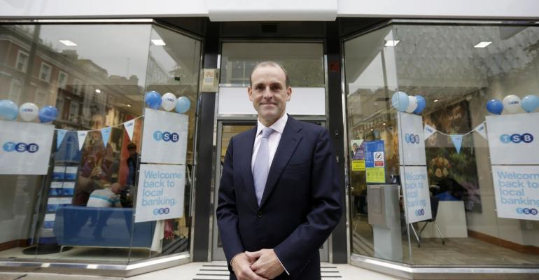 Paul Pester, the chief executive officer of TSB, part of the Lloyds Banking Group Plc, poses for a photograph outside a newly rebranded branch of the bank in London, U.K., on Monday, Sept. 9, 2013. Photographer: Matthew Lloyd