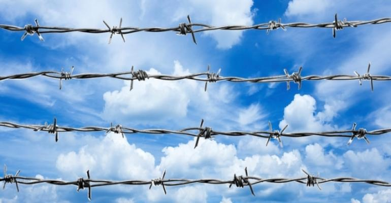 Barbed Wire Against Clouds Blue Sky