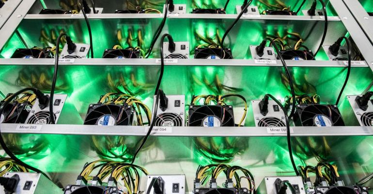 Cryptocurrency mining rigs composed of Antminer S9 ASIC machines operate on racks at the HydroMiner GmbH cryptocurrency mining facility near Waidhofen an der Ybbs, Austria, on Friday, Jan. 19, 2018. Photographer: Akos Stiller/Bloomberg