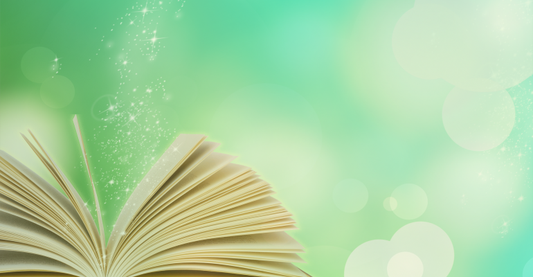 A book opening up and sparkling with magic