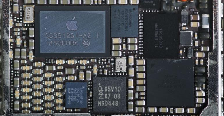 The logic board of an Apple Inc. iPhone 6 smartphone is arranged for a photograph in Bangkok, Thailand, on Saturday, Feb. 3, 2018. Apple Chief Executive Officer Tim Cook told shareholders on Feb. 13 at the company's annual meeting to expect higher dividends and stressed that succession planning is a priority. Photographer: Brent Lewin/Bloomberg