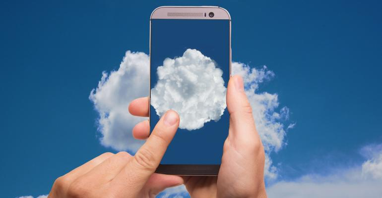 Hands holding a smartphone with images of clouds