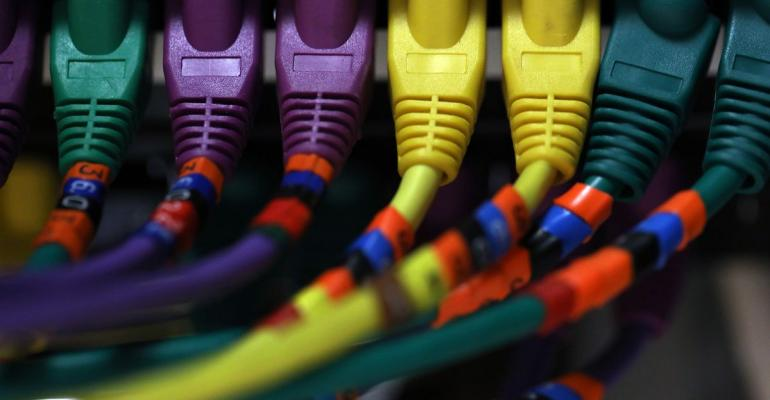 Ethernet cables connect a computer server unit inside a communications room at an office in London, U.K., on Monday, May 15, 2017. Governments and companies around the world began to gain the upper hand against the first wave of an unrivaled global cyberattack, even as the assault was poised to continue claiming victims this week. Photographer: Chris Ratcliffe/Bloomberg