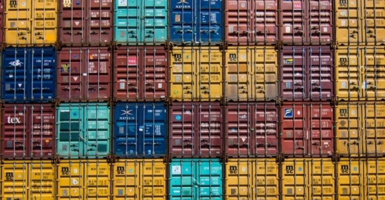Colorful shipping containers stacked high and wide