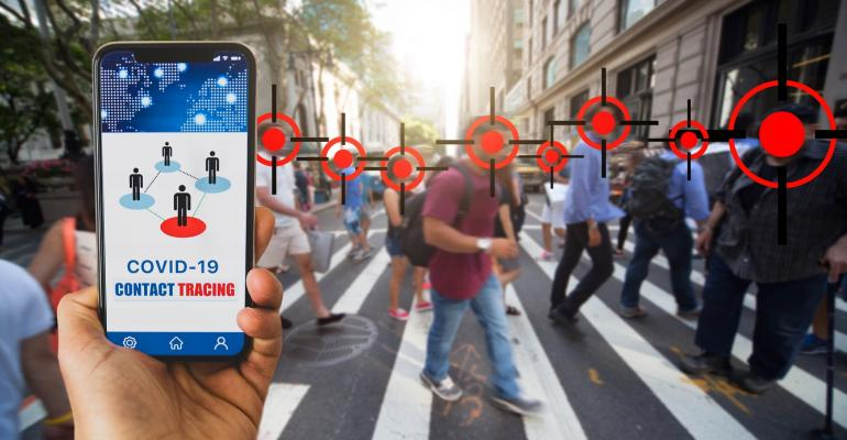 pedestrians using contact tracing app on their phones