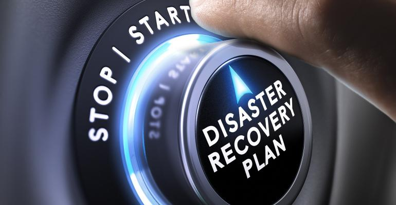 hand turning a dial to start disaster recovery plan