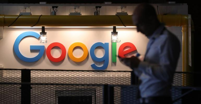 The Google Inc. logo sits illuminated on the company's exhibition stand at the Noah Technology Conference in Berlin, Germany, on Wednesday, June 6, 2018. Photographer: Krisztian Bocsi/Bloomberg