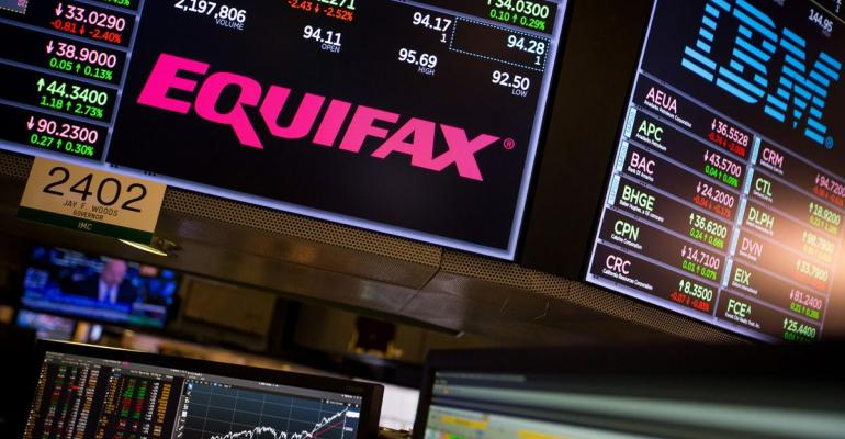 A monitor displays Equifax Inc. signage on the floor of the New York Stock Exchange (NYSE) in New York, U.S., on Friday, Sept. 15, 2017. Photographer: Michael Nagle/Bloomberg