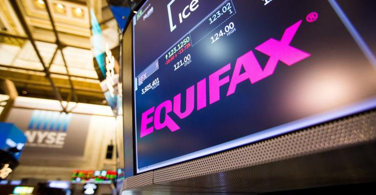 A monitor displays Equifax Inc. signage on the floor of the New York Stock Exchange (NYSE) in New York, U.S., on Friday, Sept. 8, 2017. The dollar fell to the weakest in more than two years, while stocks were mixed as natural disasters damped expectations for another U.S. rate increase this year. Photographer: Michael Nagle/Bloomberg