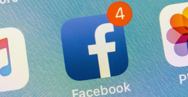 The Facebook Inc. application icon is displayed on an Apple Inc. iPhone in an arranged photograph taken in New York, U.S., on Thursday, July 26, 2018. Facebook shares plunged 19 percent Thursday after second-quarter sales and user growth missed Wall Street estimates. Photographer: Johannes Berg/Bloomberg